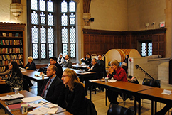 Attendees watch the symposium