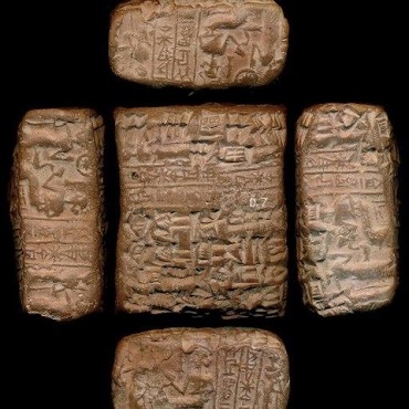 Picture of four sides of a clay tablet inscribed in cuneiform