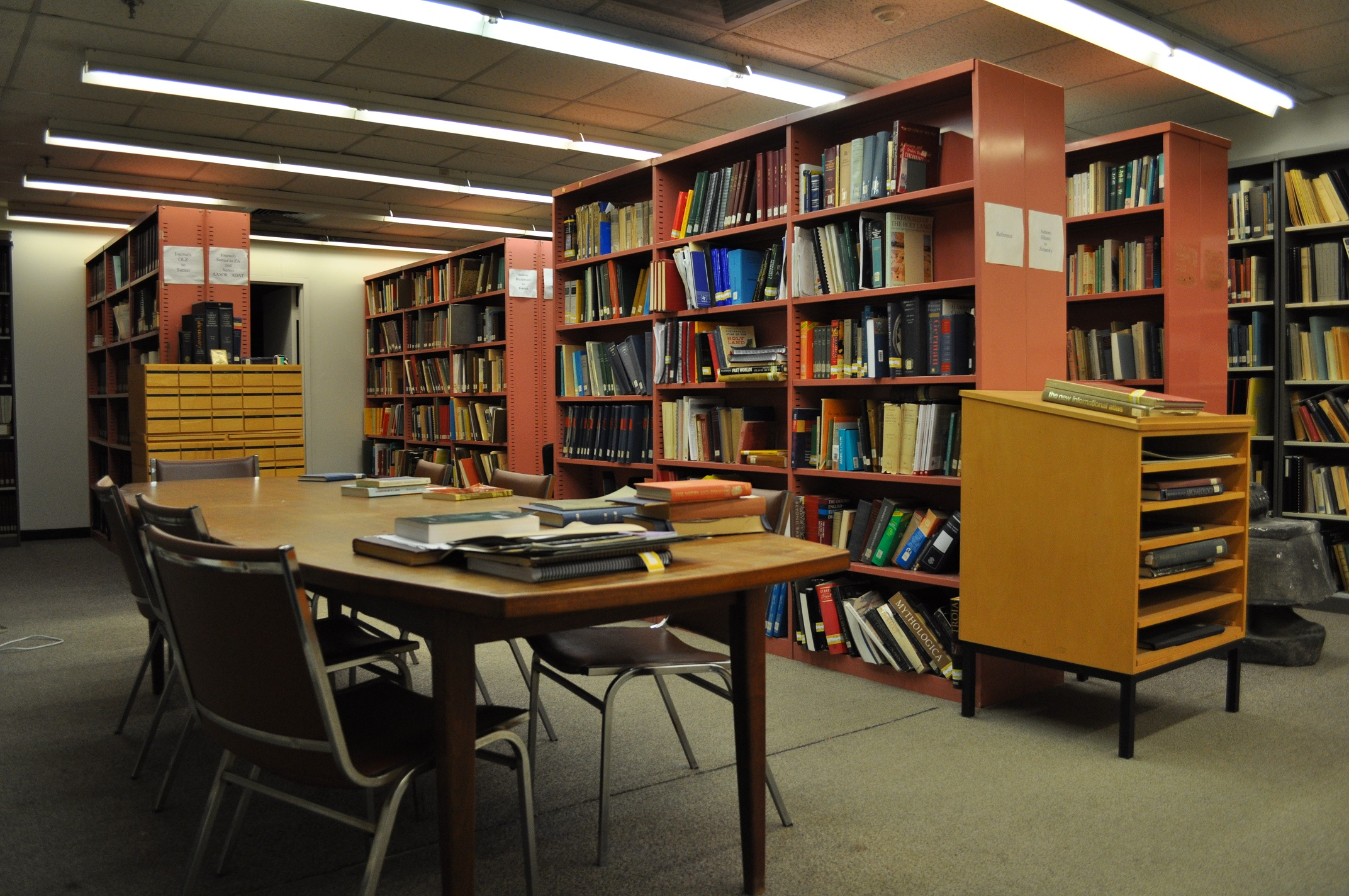library with desks, chairs and bookshelves