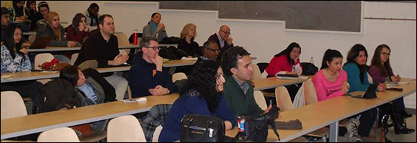 Attendees of the symposium sitting in the audience