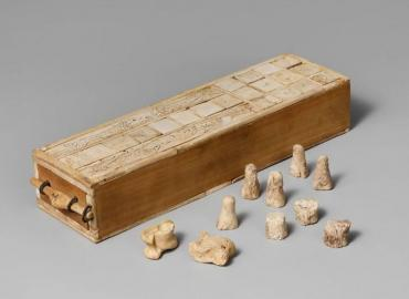 game box made from wood and animal bones, and gaming pieces made from animal bones